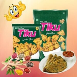 Green color packet of Tiku Methi Puri with some spices in spoons